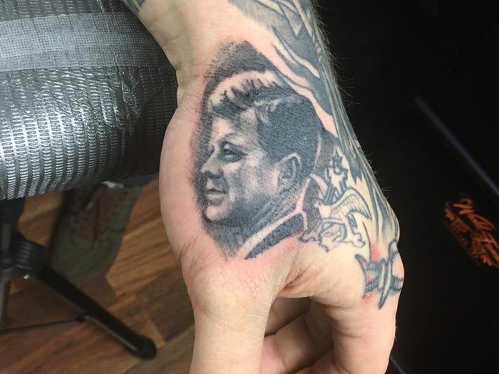 16 JFK Tattoo On Left Hand